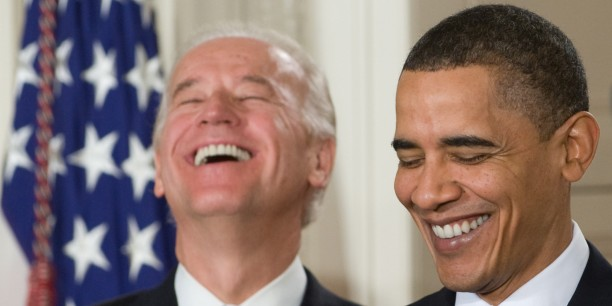 US President Barack Obama (R) laughs alongside US Vice President Joe Biden prior to signing the healthcare insurance reform legislation during a ceremony in the East Room of the White House in Washington, DC, March 23, 2010. Obama Tuesday signed into law sweeping reforms that will for the first time ensure health care coverage for almost every American. AFP PHOTO / Saul LOEB (Photo credit should read SAUL LOEB/AFP/Getty Images)
