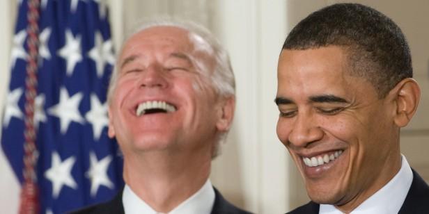 US President Barack Obama (R) laughs alo