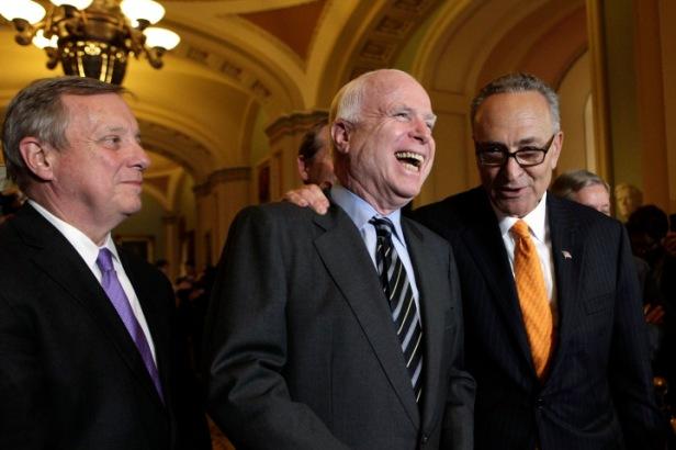 U.S. Senators Richard Durbin, John McCain and Chuck Schumer speak to the media after the Senate passed the immigration bill in Washington
