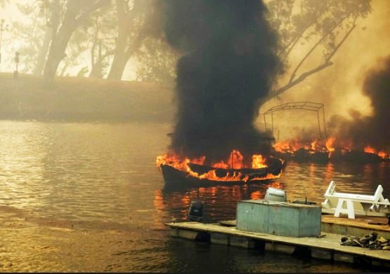 Boats Burning on Water while Trees are still Green