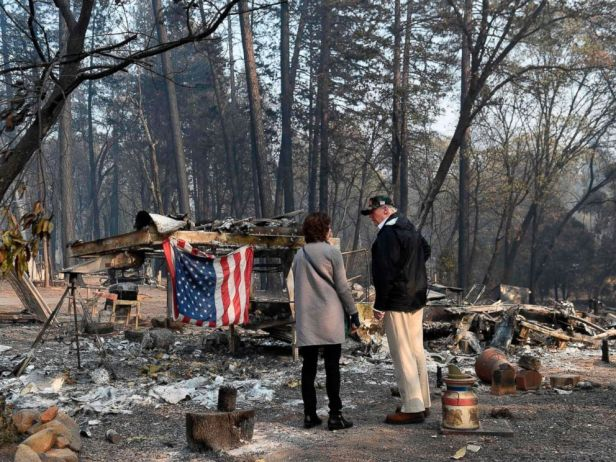 . Trump An_American_flag_is_pictured_hanging_on_a_burnt_remains_of_a_dev-a-11_15425153984942